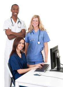 Three Healthcare Providers At Computer
